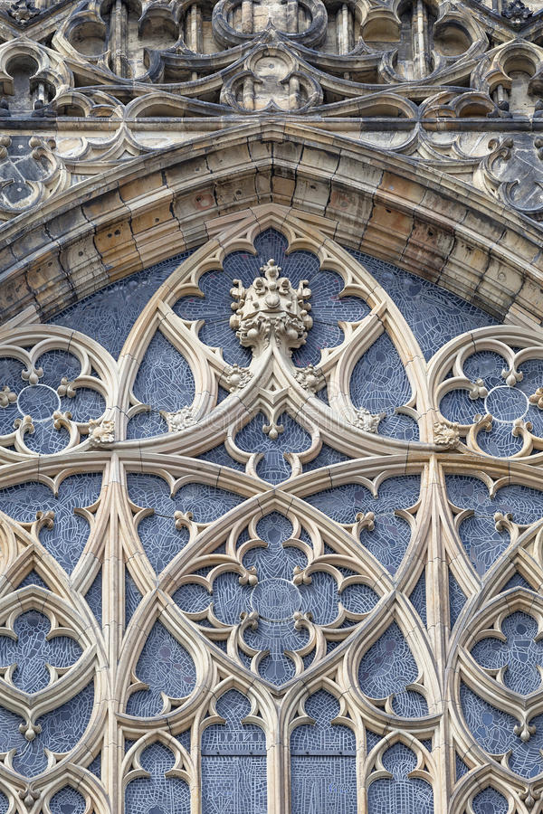 14th century St. Vitus Cathedral , facade, window with stained stained glass, Prague, Czech Republic royalty free stock image
