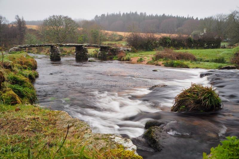 13th century stone clapper bridge built over the East Dart River at Postbridge, Dartmoor National Park, Devon, UK stock photos