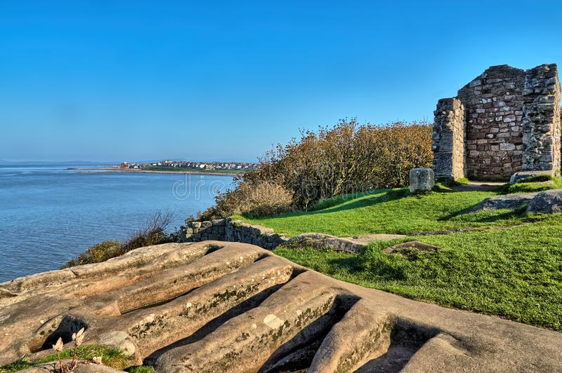 11th century stone graves in the ruins of the ancient St. Patrick`s Chapel, Heysham, Lancashire, Northern England. stock photography