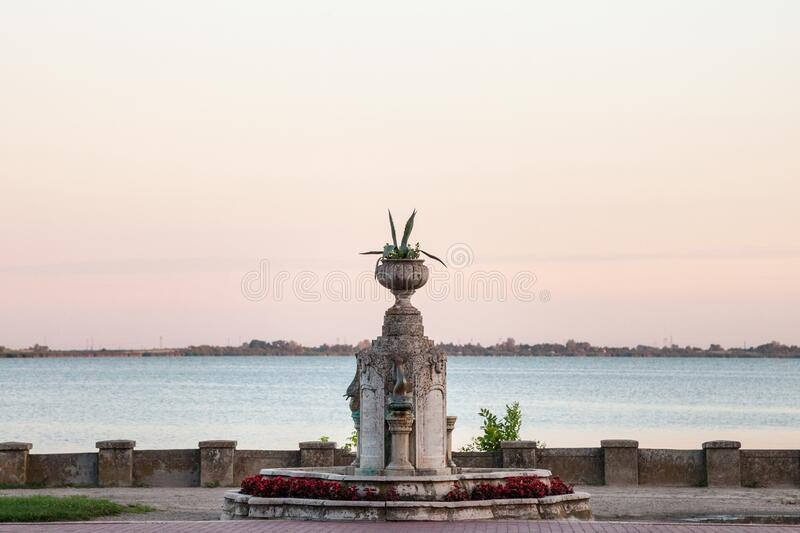 17th century water fountain of the Palic Lake, in Subotica, Serbia during a summer sunset. Also known as Palicko Jezero, it is one of the main attractions of royalty free stock photo