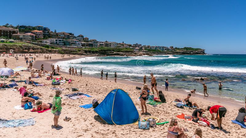 People and families with beach tent enjoying hot sunny summer day on Bronte beach in Sydney NSW Australia. 24th December 2018, Bronte Sydney Australia: people stock photo