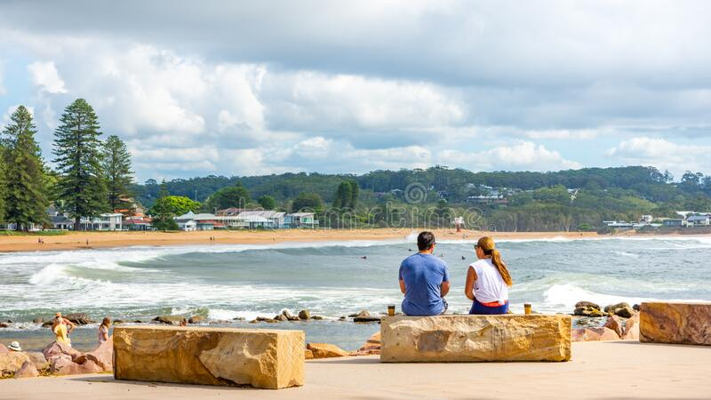 20th Feb 2020 - Avoca Beach NSW, Australia : Man and a woman share a scenic beach view while having a coffee. Outdoors lifestyle travel concept editorial stock photography
