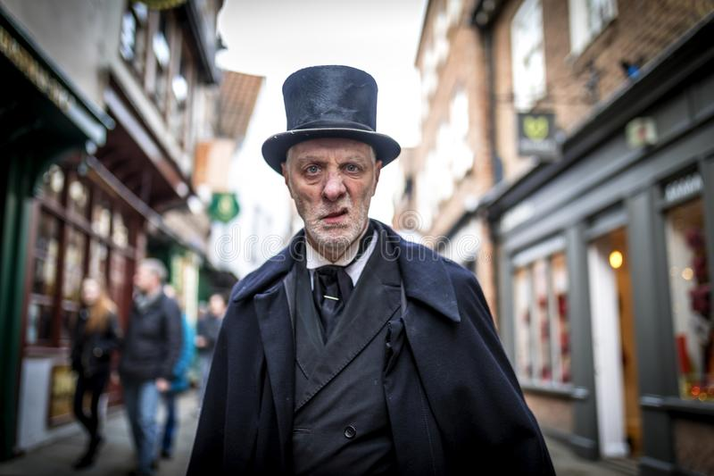 16th February 2018, The Shambles, York. Ghost Tour guide dressed as a menacing Victorian male undertaker sneering at the camera stock images