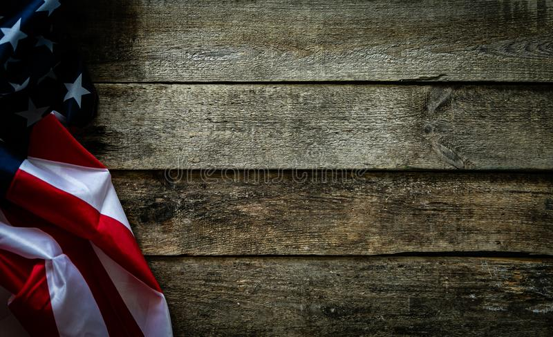4th of July concept - wood backgrouns with american flag. Copy space royalty free stock image
