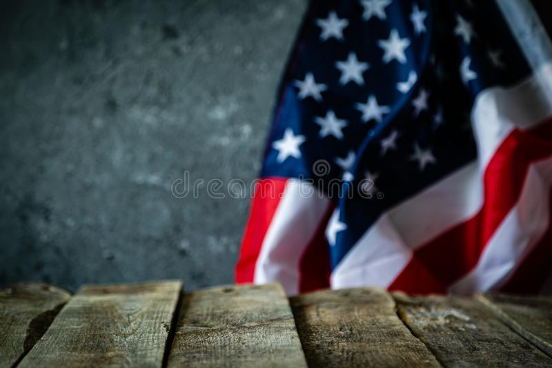 4th of July concept - wood backgrouns with american flag. Copy space royalty free stock photography