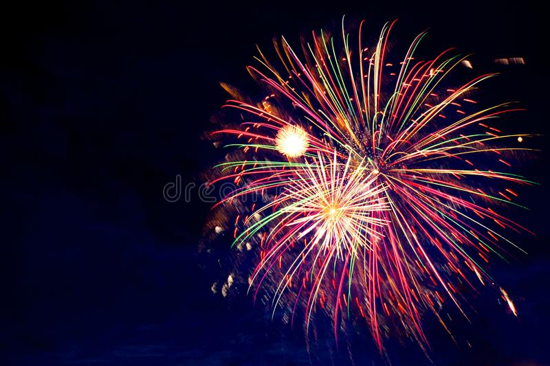 4th July fireworks. Fireworks display on dark sky background royalty free stock images