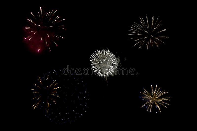 4th of July Fireworks. Sparkling round fireball charges exploding in pitch black sky of 4th of July celebration night stock photos
