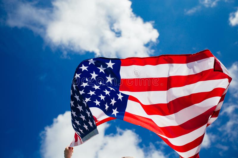 4th of July - Independence day. American flag blown in the wind, background, beautiful, blue, celebrate, celebrating, celebration, country, dream, female royalty free stock photos