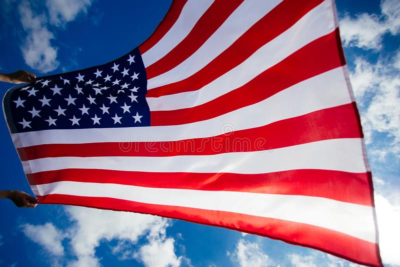 4th of July - Independence day. American flag blown in the wind, background, beautiful, blue, celebrate, celebrating, celebration, country, dream, female stock photo