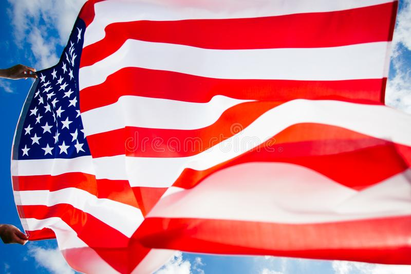 4th of July - Independence day. American flag blown in the wind, background, beautiful, blue, celebrate, celebrating, celebration, country, dream, female stock image