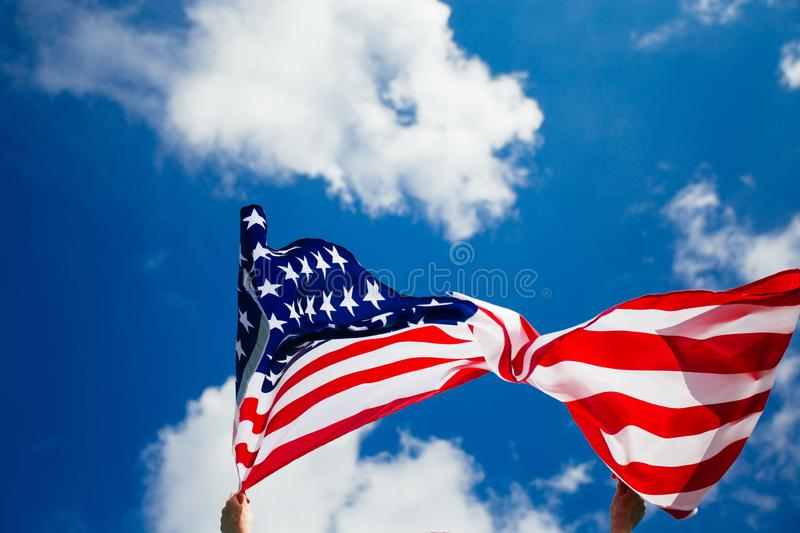 4th of July - Independence day. American flag blown in the wind, background, beautiful, blue, celebrate, celebrating, celebration, country, dream, female royalty free stock image