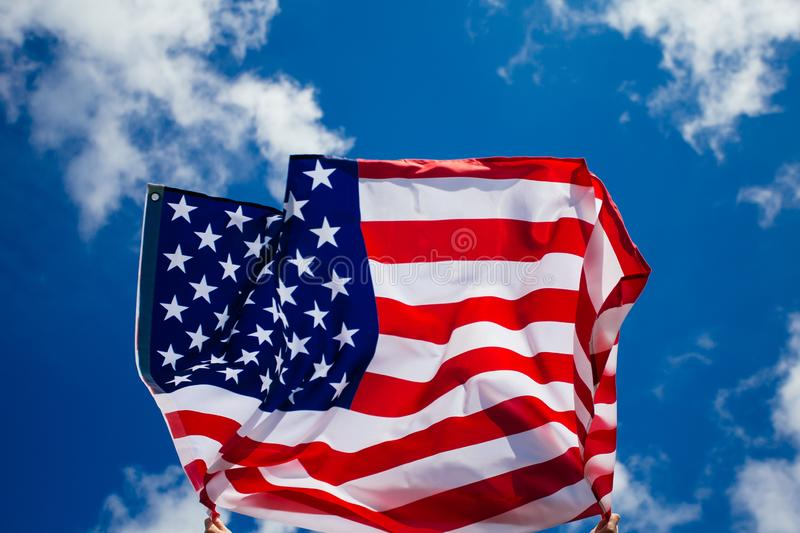 4th of July - Independence day. American flag blown in the wind, background, beautiful, blue, celebrate, celebrating, celebration, country, dream, female royalty free stock photo
