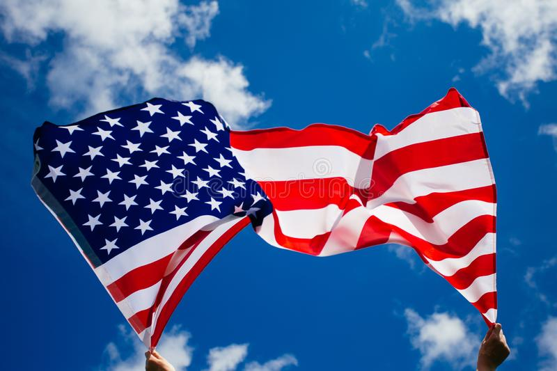4th of July - Independence day. American flag blown in the wind, background, beautiful, blue, celebrate, celebrating, celebration, country, dream, female stock photos