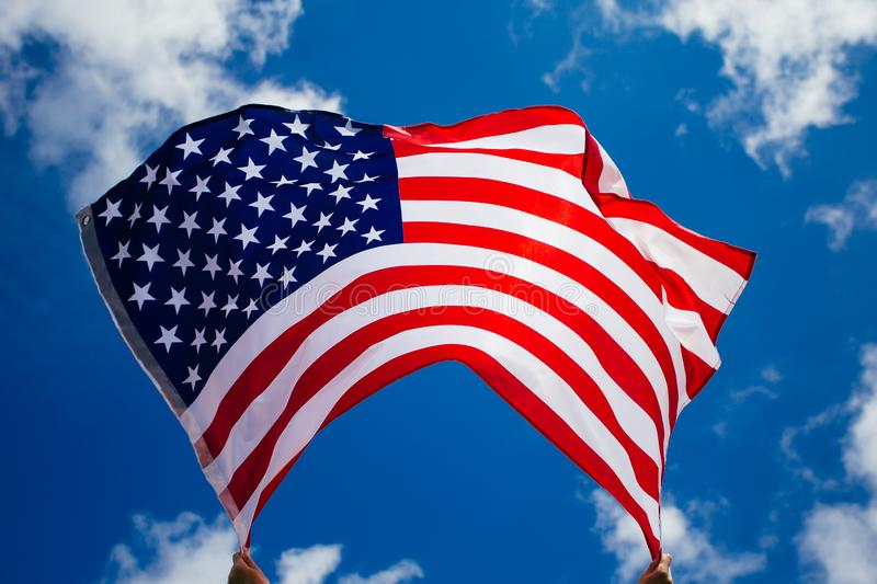 4th of July - Independence day. American flag blown in the wind, background, beautiful, blue, celebrate, celebrating, celebration, country, dream, female royalty free stock photography