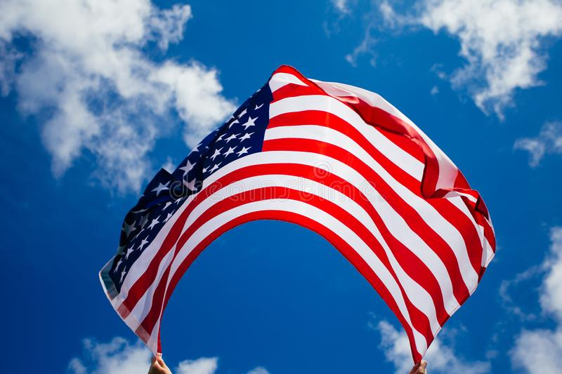 4th of July - Independence day. American flag blown in the wind, background, beautiful, blue, celebrate, celebrating, celebration, country, dream, female stock photography