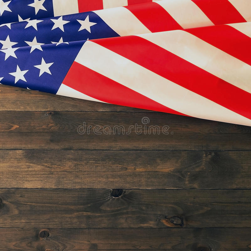 4th of July, the US Independence Day, place to advertise, wood background, American flag. United States of America royalty free stock photos