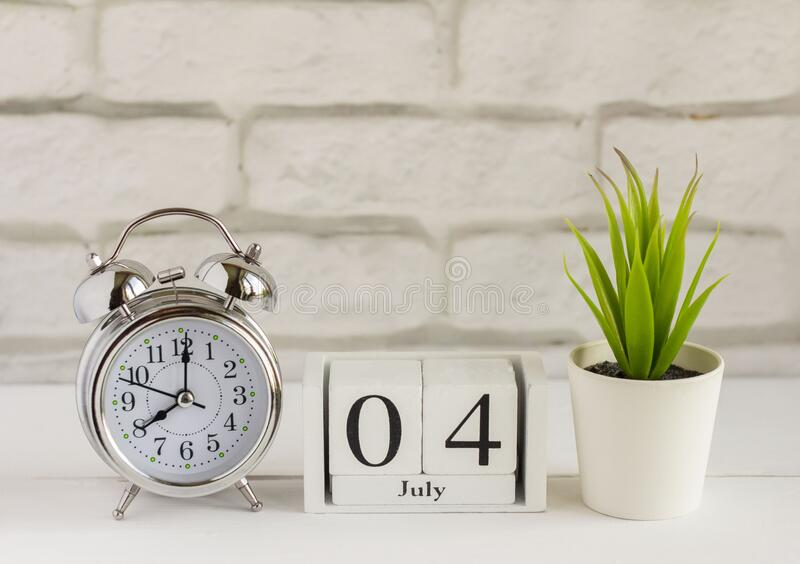 The 4th Of July. Wooden Calendar With Date And Table Clock ...