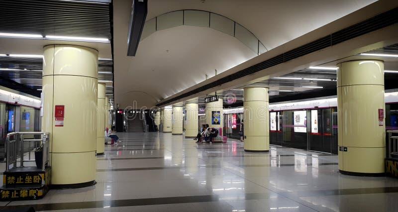 19th of May, 2018: Subway platform hall with few people waiting at Beijing city, China stock image
