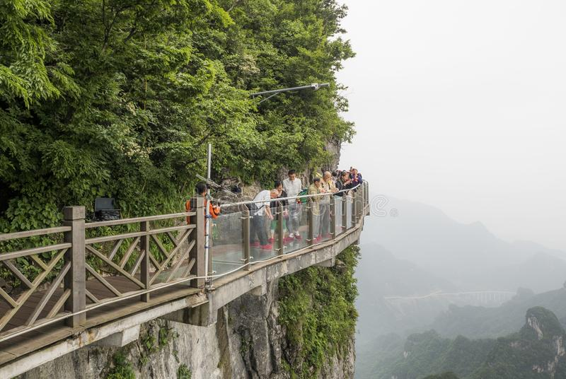 28th of May, 2018: Tourists preparing to have their pictures taken at the Cliff Glass Sky Walk at Tianmen Mountain, The Heaven`s royalty free stock photos