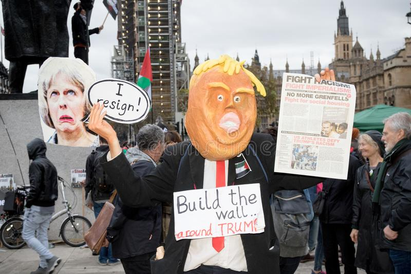 National Demo: Justice Now - Make it right for Palestine London. 4th November 2017, London, United Kingdom:-Man dressed as Donald Trump at a pro palestine royalty free stock photos