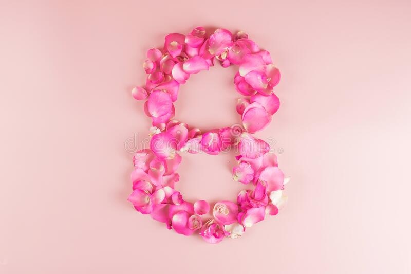 8th number shape of Pink Rose flower petal on pink background with copy space for text. Love, Equal and International Women day. Concept stock photos