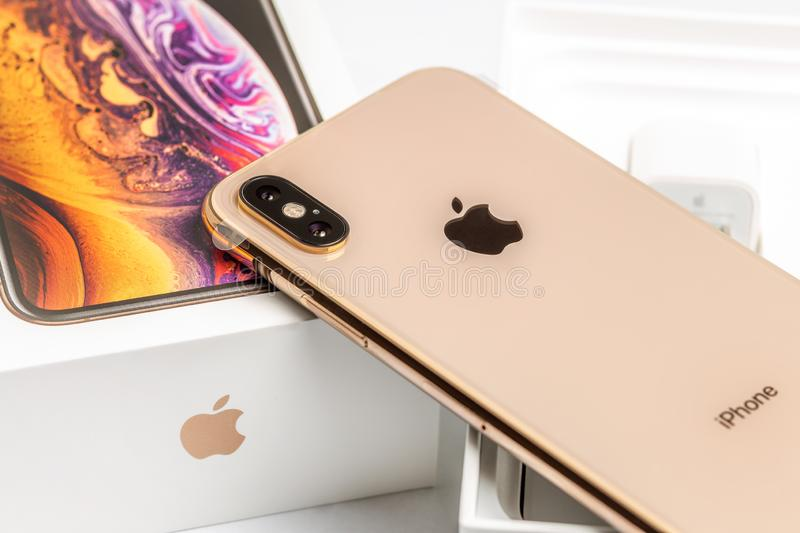 12th October,2018-Kiev,Ukraine: Latest Iphone XS on opened box on white table. Newest Apple smartphone on white branded. Box in mobile store. Modern gadget with royalty free stock photo