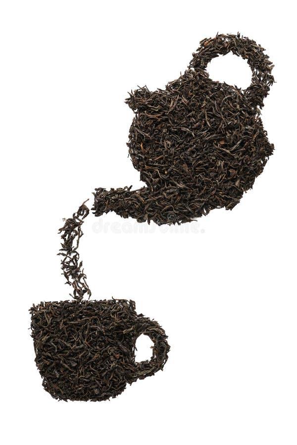 Th? se renversant de th?i?re dans une cuvette Silhouette faite en thé noir sec photos stock