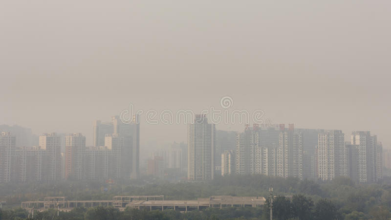 18th Sep,2014-Beijing,China. Wide angle horizontal shot of bui. Ldings in beijing on a foggy day.the word on building show the name of bussine company stock image