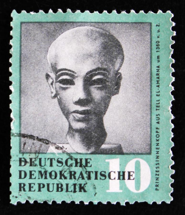 20th Soviet Space research program, circa 1978. MOSCOW, RUSSIA - APRIL 2, 2017: A post stamp printed in Germany shows doll head of Egyptian princess Amarna royalty free stock photography
