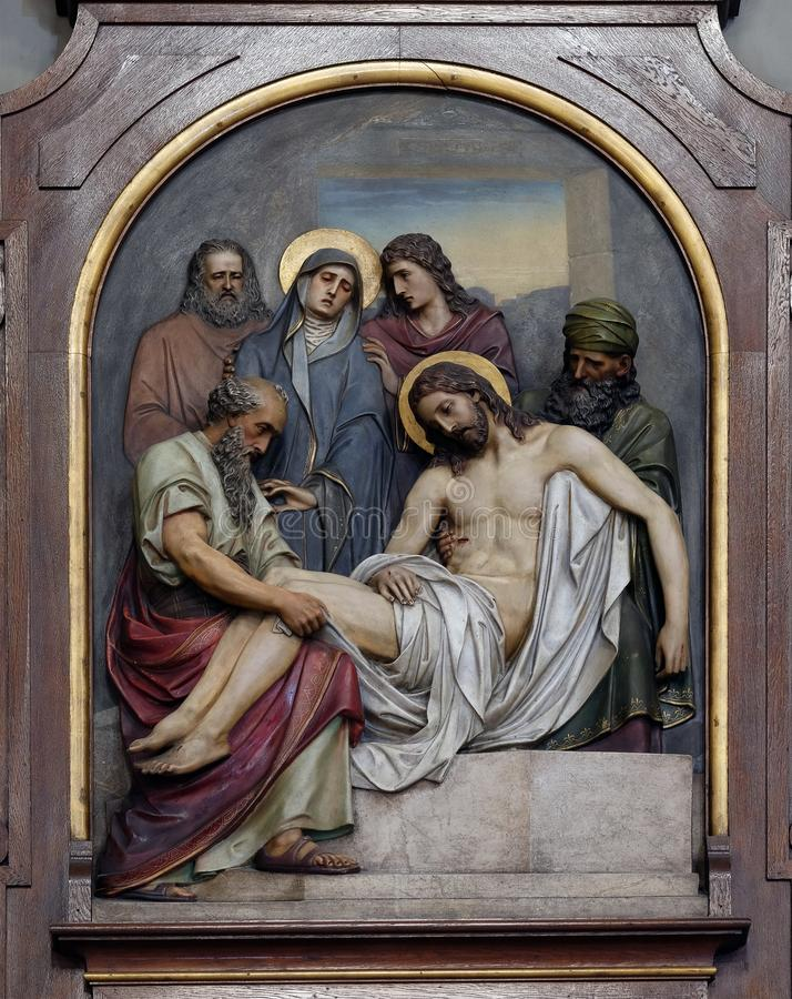 14th Stations of the Cross, Jesus is laid in the tomb and covered in incense royalty free stock photos