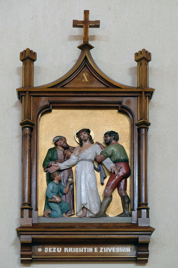10th Stations of the Cross, Jesus is stripped of His garments. Mother Teresa cathedral in Vau i Dejes, Albania royalty free stock image