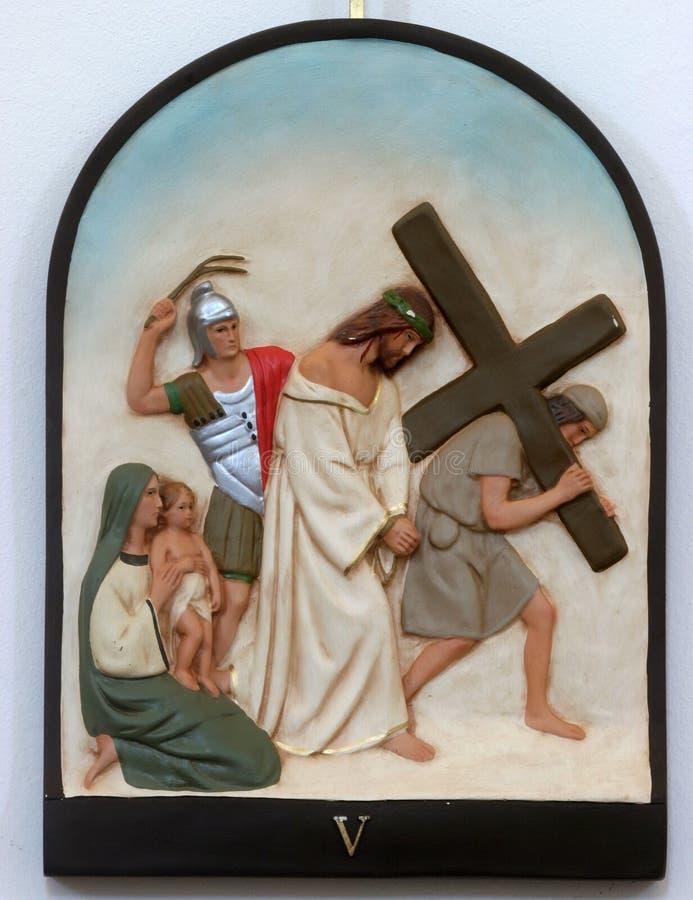 5th Stations of the Cross, Simon of Cyrene carries the cross. Holy Trinity church in Hrvatska Dubica, Croatia stock photos