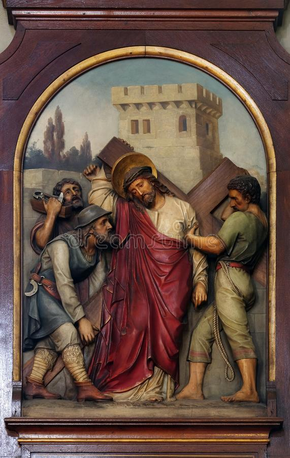 5th Stations of the Cross, Simon of Cyrene carries the cross. Basilica of the Sacred Heart of Jesus in Zagreb, Croatia royalty free stock images