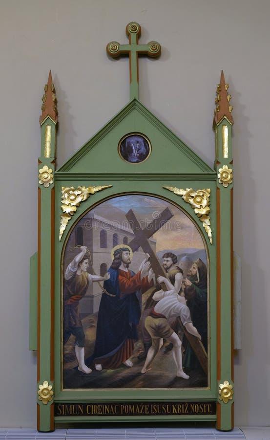 5th Stations of the Cross, Simon of Cyrene carries the cross. Church of Saint Matthew in Stitar, Croatia stock photos