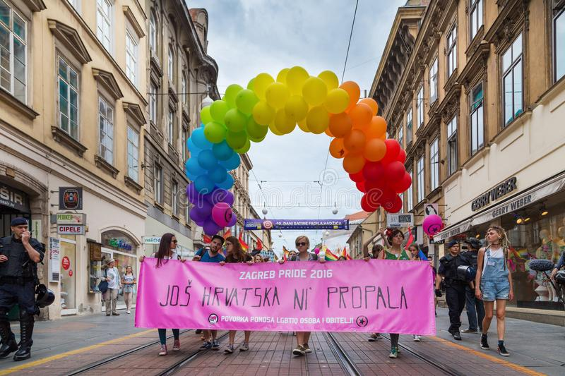 15th Zagreb pride. LGBTIQ activists holding pride banner. royalty free stock photography