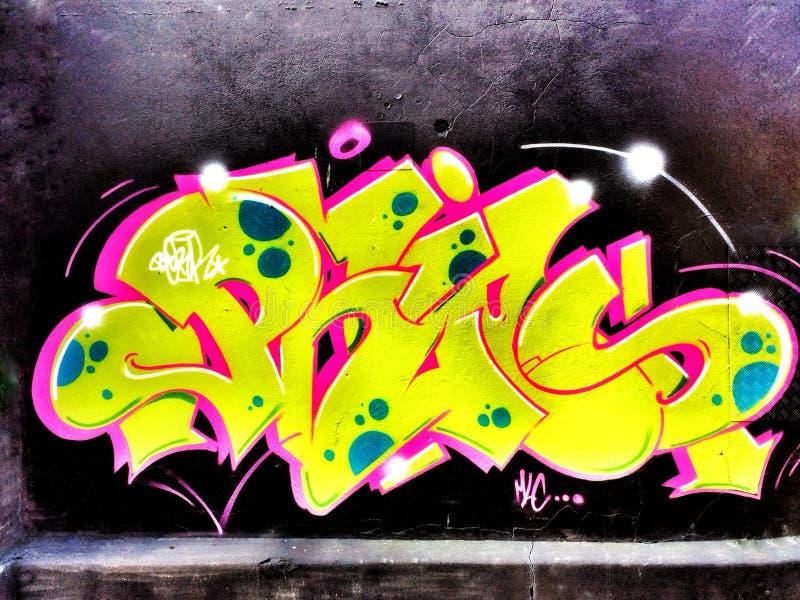In tha hood. Steetart awsome yellow pink grafitti art street urban wall spraypaint stock images