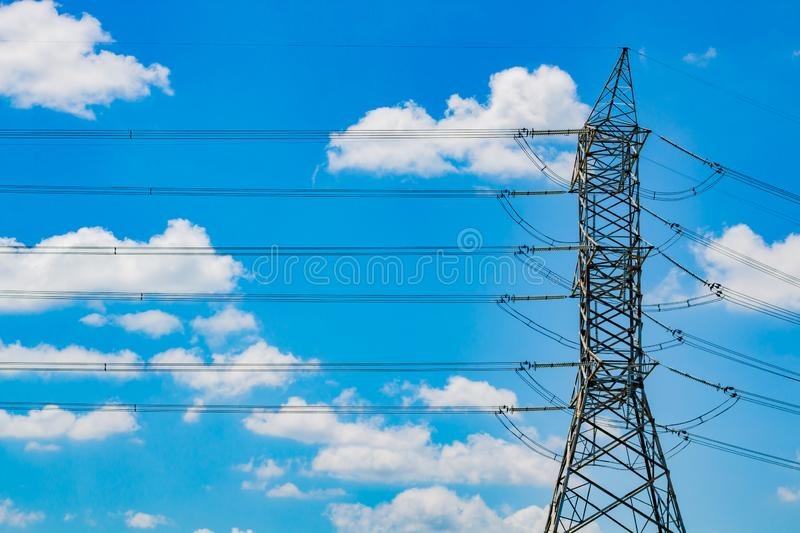 High voltage electric pole on sky background. Cable electric stock image