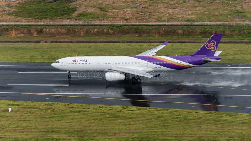 Thai airway depart at Phuket Airport in rainny day. Phuket, Thailand ; September 14,2558 Thai airway airplane depart at phuket airport in rainny day and runway royalty free stock photo