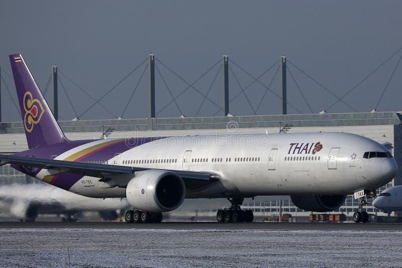 Thai Airways International taxiing in Munich Airport, winter stock photo
