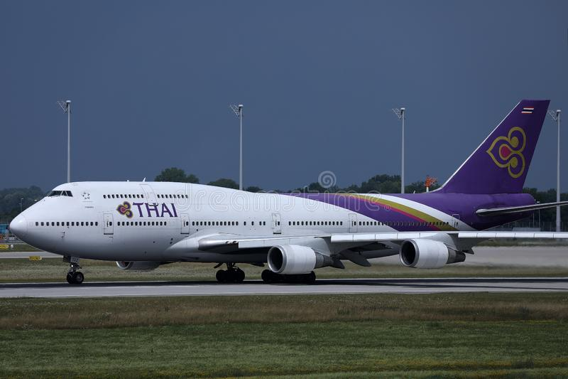 Thai Airways International taxiing in Munich Airport, winter royalty free stock photo