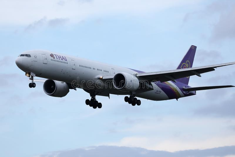 Thai Airways International plane flying up in the sky stock photography
