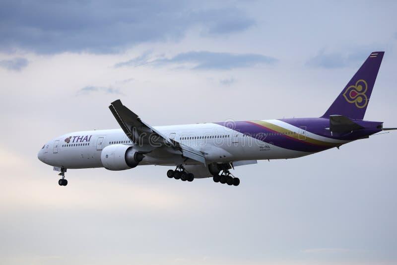 Thai Airways International plane flying up in the sky stock image