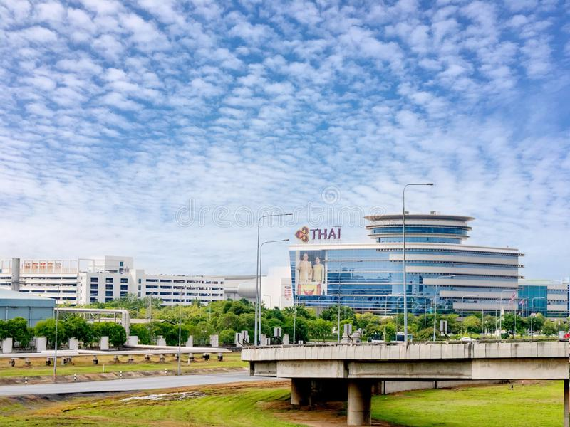 Thai airways operation centerOPC building at suvarnnabhumi airport with Thai king and queen poster at the wall. Bangkok, royalty free stock image