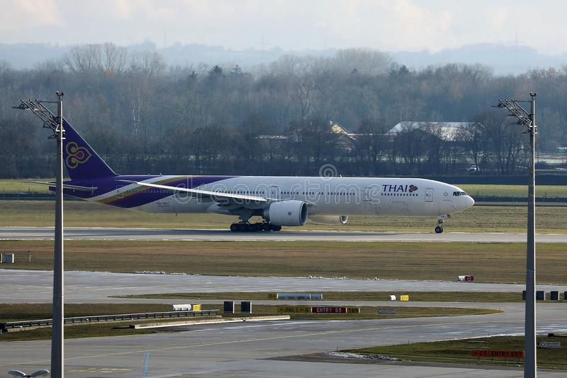 Thai Airways taxiing in Munich Airport, MUC, side view royalty free stock photography