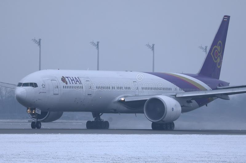 Thai Airways taxiing in Munich Airport, MUC, snow on runway royalty free stock image
