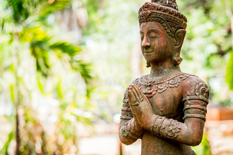 Thai ancient angel act like paying respect or sawasdee.  royalty free stock image