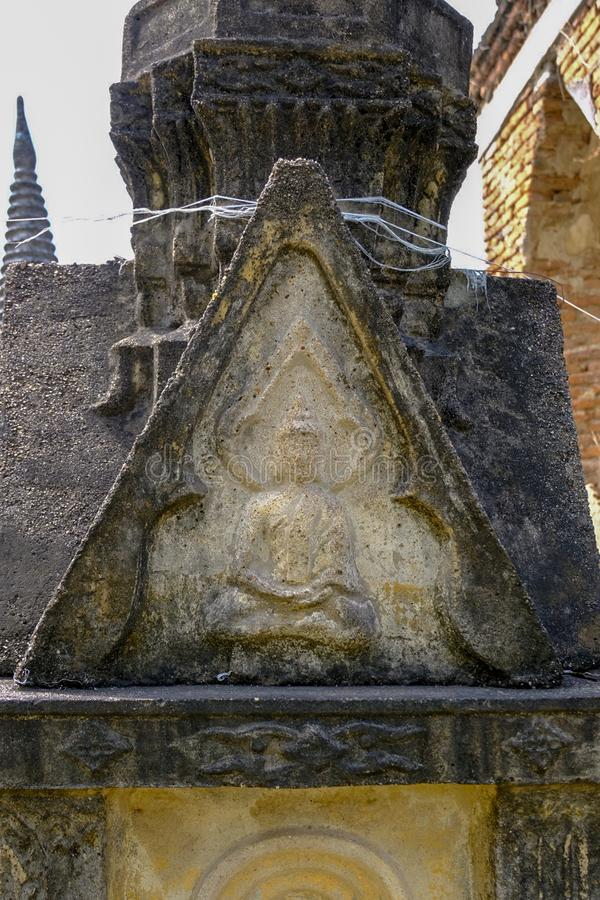Thai Ancient Buddha carving from sandstone in Ayutthaya period royalty free stock photography