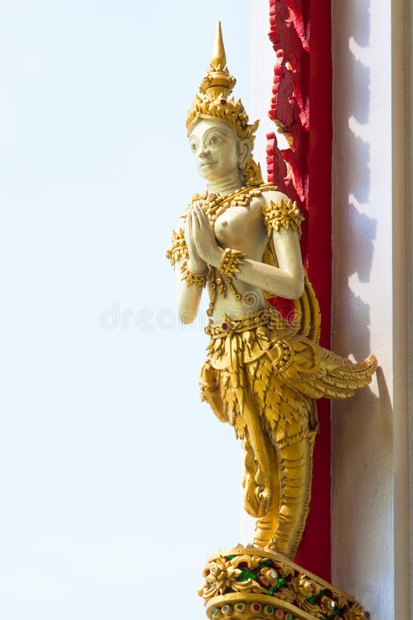 Thai angel statue in thai style at temple. Native Thai Style of half angle half bird sculpture at temple in Thailand , General in Thai no potential trademark or stock photography