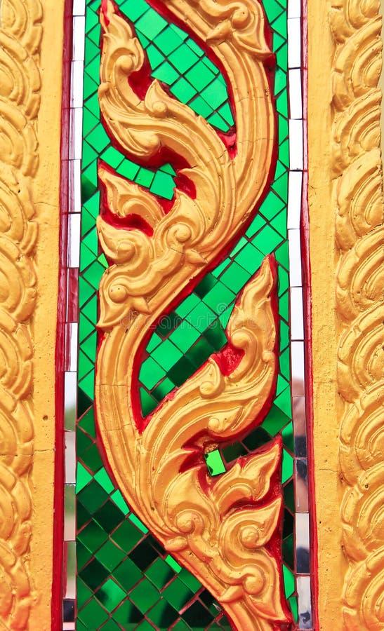 Thai art. Handmade Thai art on the wall at the temple stock photography