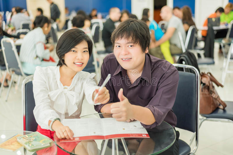 Thai (Asian) business copule are showing success gesture in the royalty free stock images